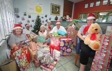 staff with ray of giving presents