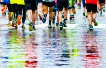 abstract picture of people running a marathon on a wetted surface